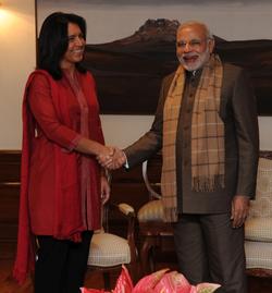 Gabbard with                                 Indian Prime Minister                                                 Narendra Modi                                in New Delhi; December 2014.