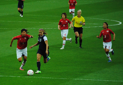 Morgan challenges Japanese defender Saki Kumagai for the ball as Mizuho Sakaguchi (6) and Azusa Iwashimizu (3) look on during their gold medal match at the 2012 Summer Olympics.