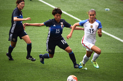 Alex Morgan outrunning a defender during a game against Japan in Cleveland on June 5, 2016