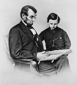 1864 photo of President Lincoln with youngest son,                                 Tad
