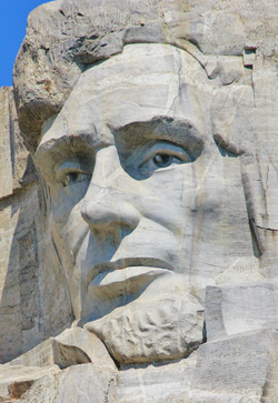 Lincoln's image is carved into the stone of                                 Mount Rushmore                                .