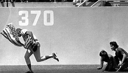 Veteran Marine Rick Monday grabs a U.S. flag from protesters.