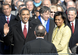 Barack Obama takes the oath of office administered by Chief Justice John G. Roberts Jr. at the Capitol, January 20, 2009