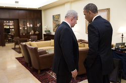 Barack Obama talks with Benjamin Netanyahu