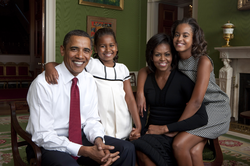Obama posing in the Green Room of the White House with wife Michelle and daughters Sasha and Malia in 2009
