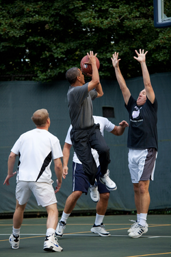 Obama taking a shot during a game on the White House basketball court, 2009