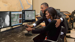 [Satire] Barack Obama handling Michelle's drone joystick. (Taken from The Onion)