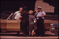 Chicago Police officer in 1973 inquiring about a traffic accident