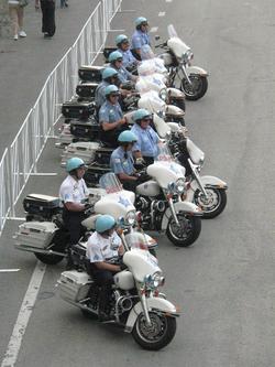 The police motorcade awaits the start of the 2007                                 Chicago Marathon                                .