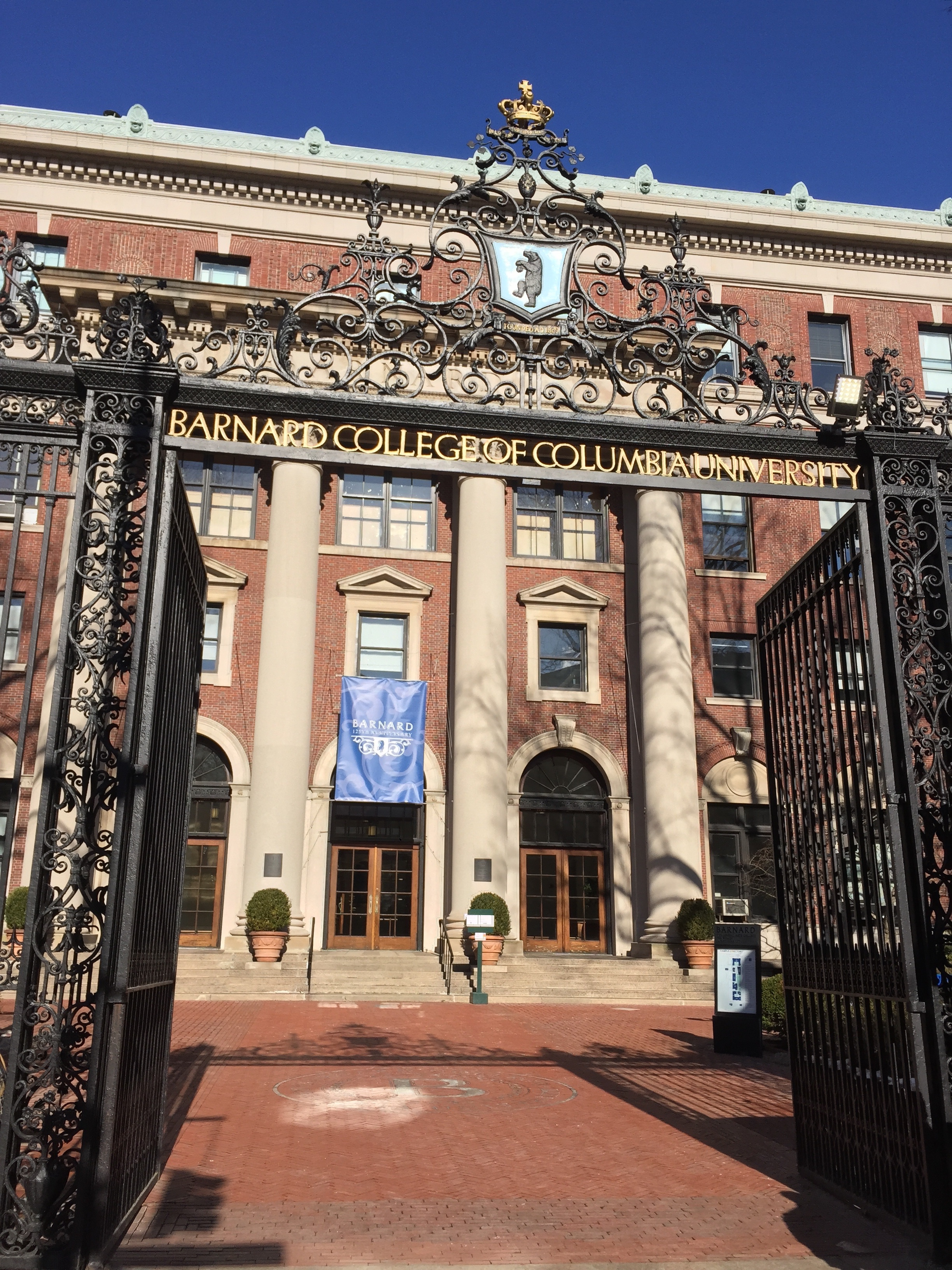"Barnard College front gates engraved in the head covering reads: ""Barnard College of Columbia University."""