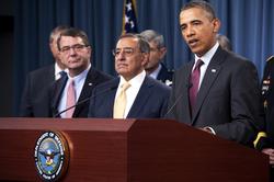 From left, Carter, Defense Secretary Leon E. Panetta, and President Barack Obama in 2012