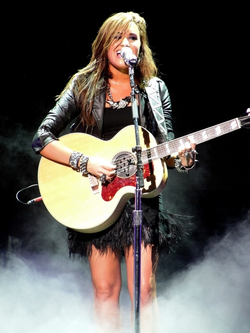 Lovato performing during the Jonas Brothers Live in Concert World Tour in September 2010
