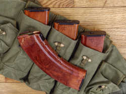 """""""Bakelite"""" rust-colored steel-reinforced 30-round plastic box 7.62×39mm AK magazines. Three magazines have an """"arrow in triangle""""                                 Izhmash                                arsenal mark on the bottom right. The other magazine has a """"star""""                                 Tula                                arsenal mark on the bottom right"""