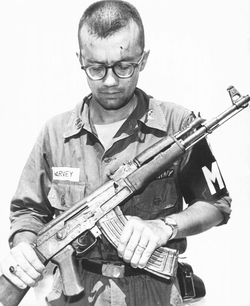 A                                 U.S. Army                                                 M.P                                inspects a Chinese AK-47 recovered in Vietnam, 1968