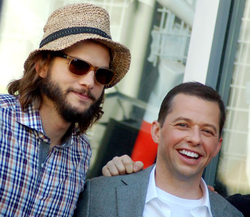 Kutcher with                                                   Two and a Half Men                                                 co-star                                 Jon Cryer                                in September 2011