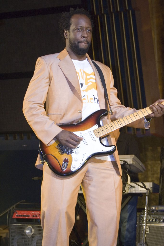 Wyclef Jean performing at a UNAIDS concert in 2006