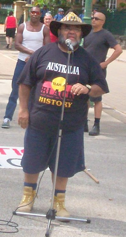 "Aboriginal activist Sam Watson addressing Invasion Day Rally 2007 in a ""White Australia has a Black History"" T-shirt"
