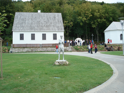 Rebuilt, Tesla's house (parish hall) in Smiljan, Croatia, where he was born, and the rebuilt church, where his father served. During the Yugoslav Wars, several of the buildings were severely damaged by fire. They were restored and reopened in 2006.[9]