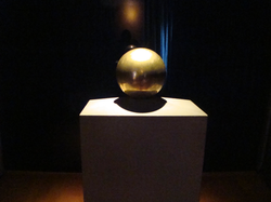 Gilded urn with Tesla's ashes, in his favorite geometrical object, a sphere (Nikola Tesla Museum, Belgrade)