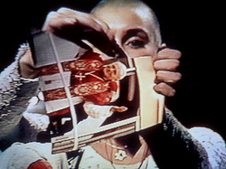 Sinéad O'Connor tears a picture of Pope John Paul II apart during a live SNL performance.