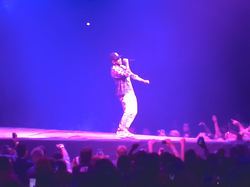 "Lamar performing ""                                 Money Trees                                "" during the                                 Yeezus Tour"