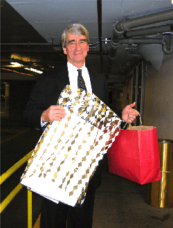 Waterston displaying gifts from fans
