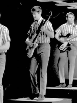 Brian performing on electric bass with the Beach Boys, 1964.