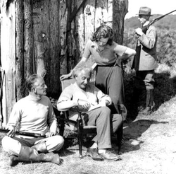 Einstein surrounded by Oliver Locker-Lampson (seated) and assistants assigned to protect him