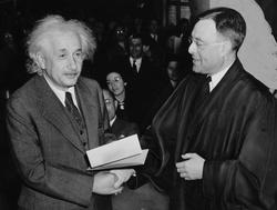 Einstein accepting U.S. citizenship certificate from judge Phillip Forman