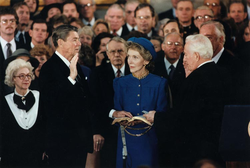 Ronald Reagan is sworn in for a second term as president by chief justice                                 Warren Burger                                in the Capitol Rotunda