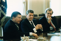 President Reagan receives the Tower Report in the                                 Cabinet Room                                of the White House in 1987.