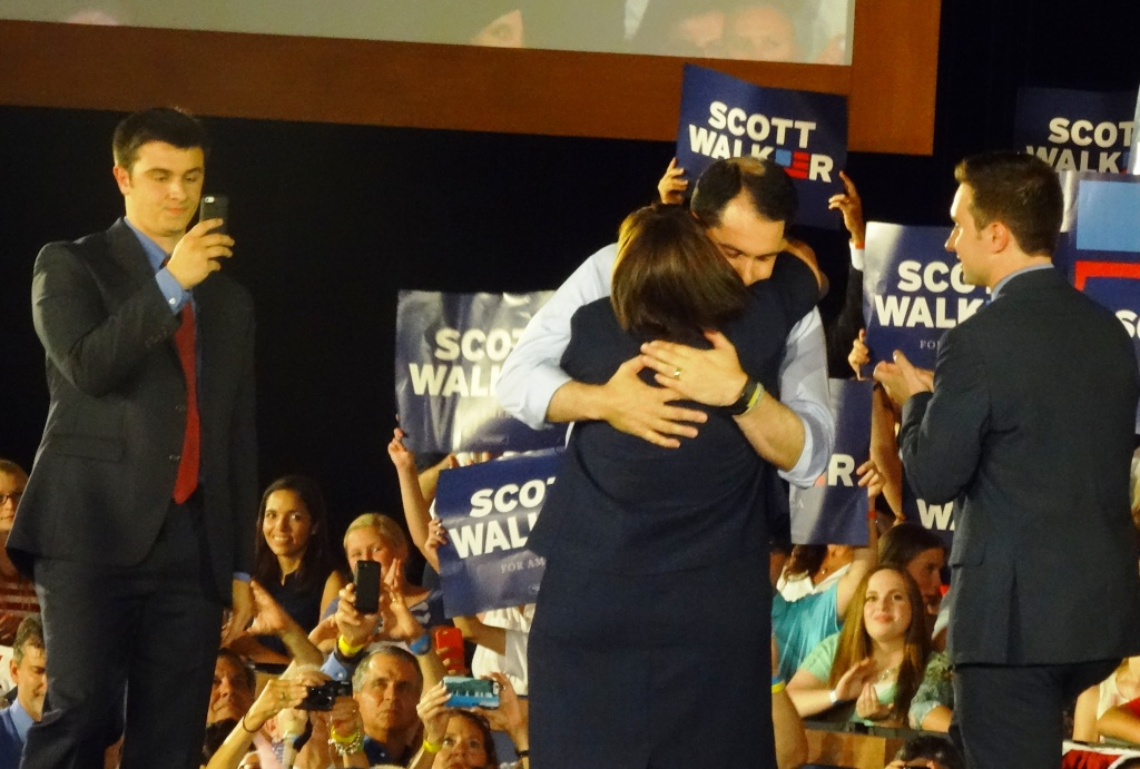 Walker hugs his wife Tonette during his 2016 presidential campaign announcement while their sons watch