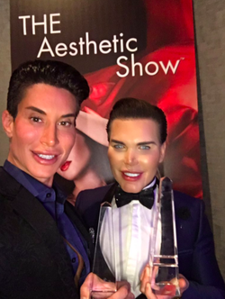 With his friend Justin Jedlica winning their awards