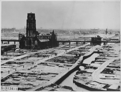 Rotterdam centre after the                                 1940 bombing of Rotterdam                                . The ruined                                 St. Lawrence' Church                                has been restored