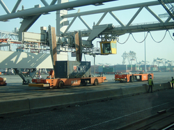 Unmanned vehicles handle containers at Europe Container Terminals (ECT), the largest container terminal operator in Europe.