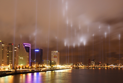 Rotterdam waterfront, with spotlights shining into the air to commemorate the                                 Rotterdam Blitz