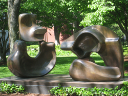 Henry Moore                                's sculpture                                 Large Four Piece Reclining Figure                                , near Lamont Library