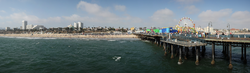 Santa Monica beach and pier viewed from the end of                                 Santa Monica Pier                                . Note that the bluff is highest at the north end, to the left of the image