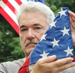 Larry Kelley with the American Flag