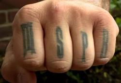 MSPR tattooed on his knuckles.