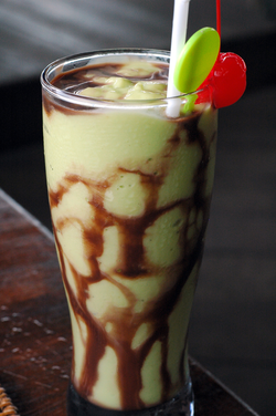 Indonesian-style                                avocado milkshake with chocolate syrup
