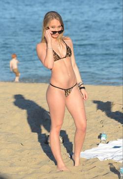 In a sexy bikini.