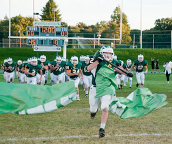 Liebowitz leading his football team out on the field