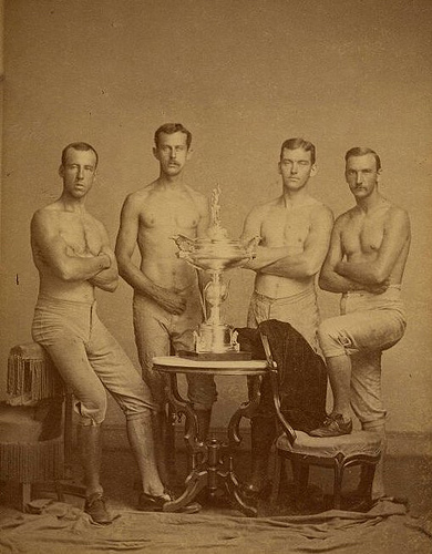 Yale's four-oared crew team, posing with 1876 Centennial Regatta trophy, won at Philadelphia.