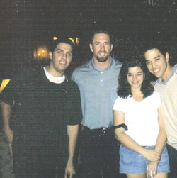Bagwell posing with a group of fans