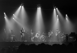 A live performance of                                 The Dark Side of the Moon                                at                                 Earls Court                                , shortly after its release in 1973: (l-r) Gilmour, Mason,                                 Dick Parry                                , Waters