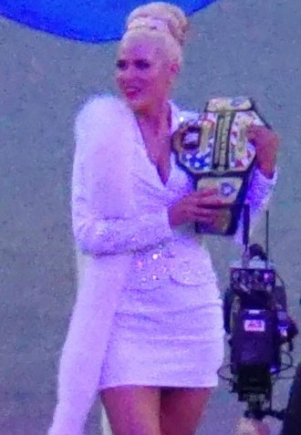 Lana holding the United States Championship at WrestleMania 31 in 2015