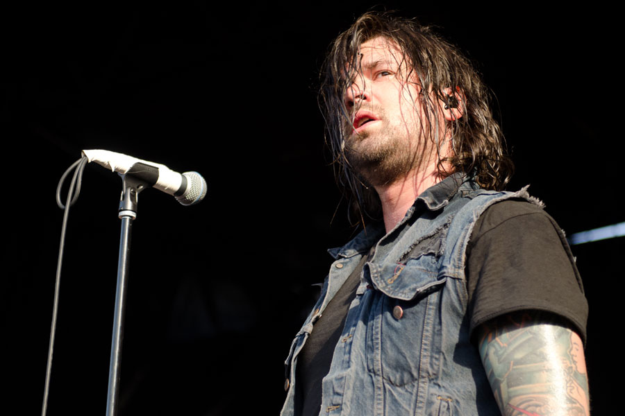 Vocalist Adam Lazzara performing with Taking Back Sunday on Warped Tour 2012