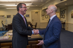 Bezos (right) meeting                                 Ash Carter                                at the                                 Pentagon                                about the                                 Defense Innovation Advisory Board                                .                                                   [6]
