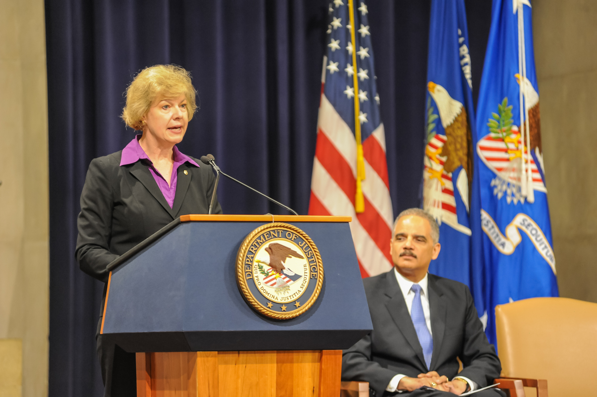 US Senator Tammy Baldwin from Wisconsin speaking at a US Department of Justice event.